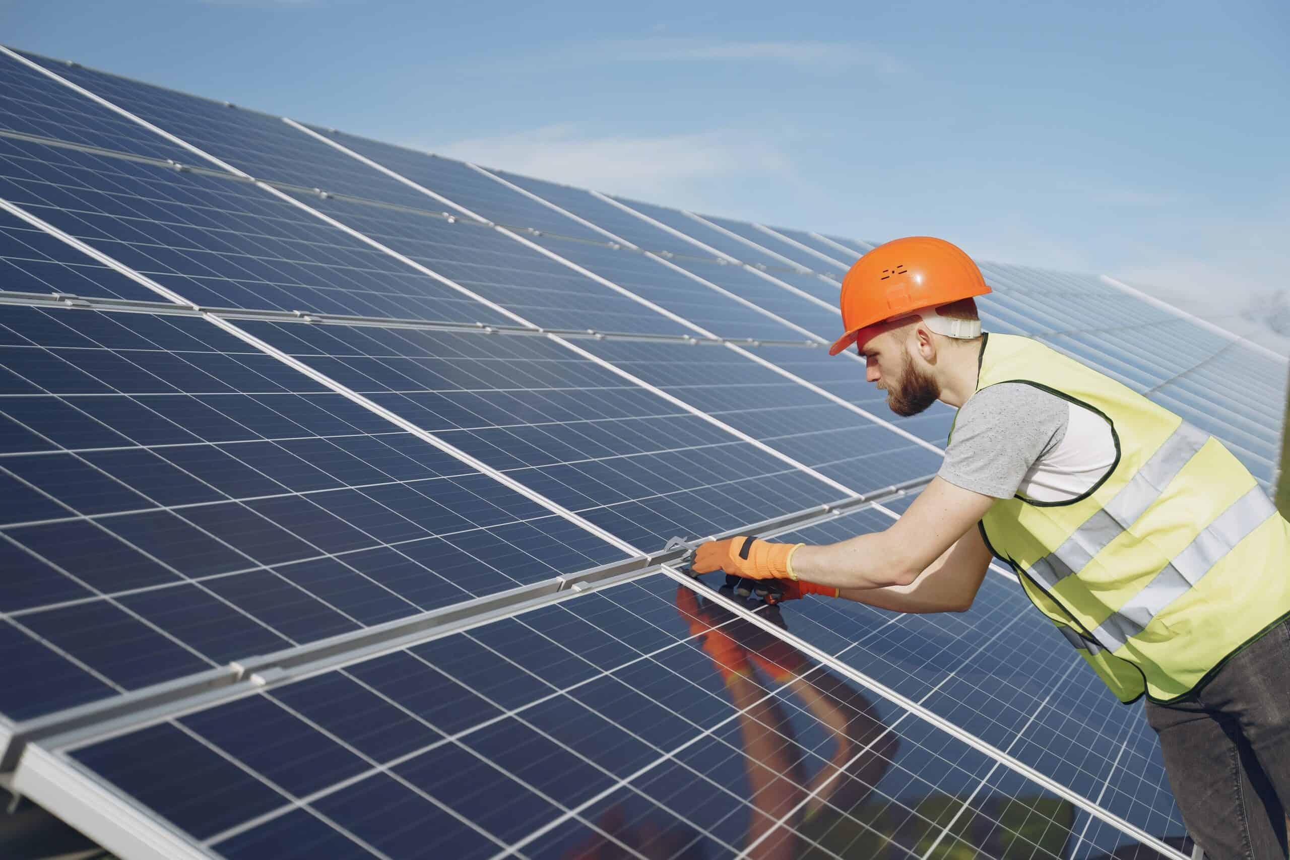 Solar panel installer inspecting solar panels